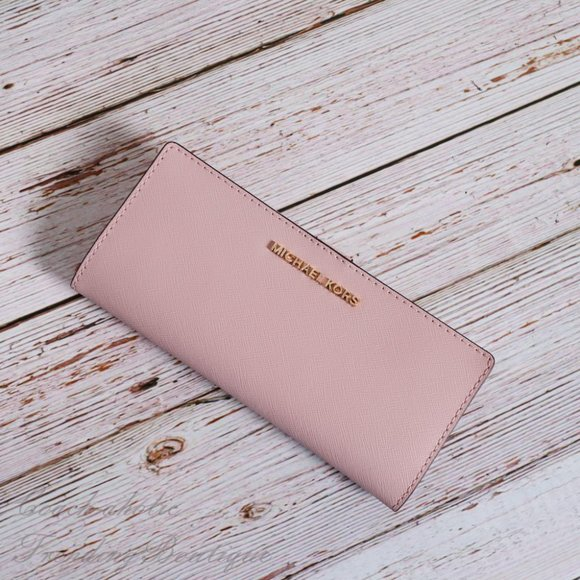 Michael Kors Handbags - NWT Michael Kors Jet Set Travel Slim Bifold Wallet